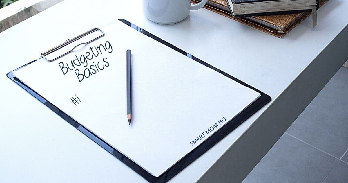clipboard laying on table with budgeting basics written on it